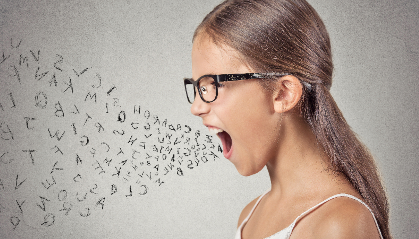 Girl with random letters pouring from mouth, as in swearing