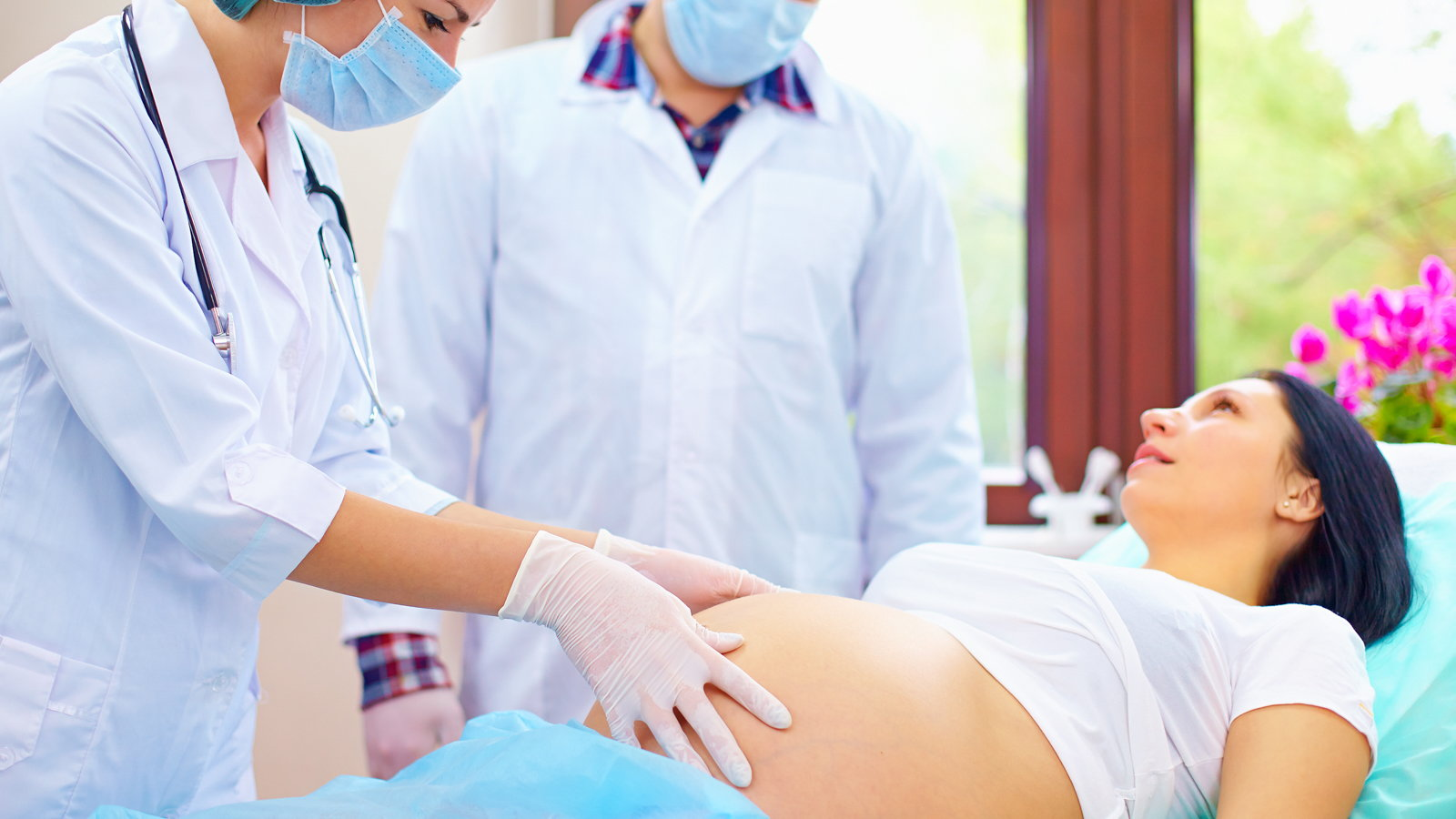 pregnant woman being examined at the hospital