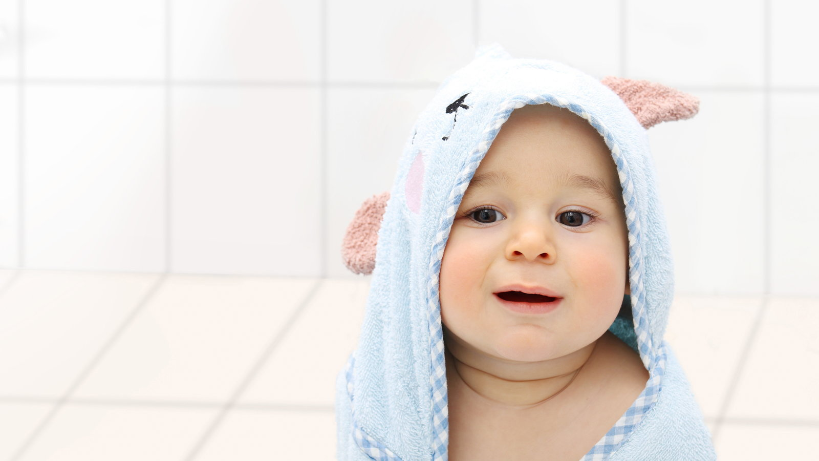 baby in bathroom after a bath