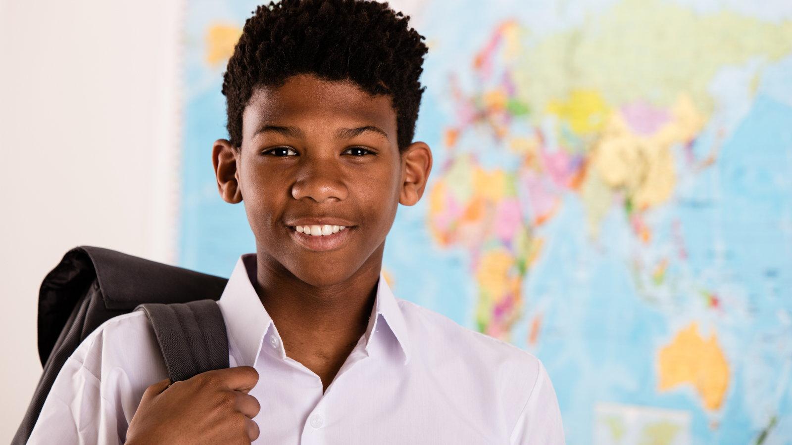 boy wearing school uniform