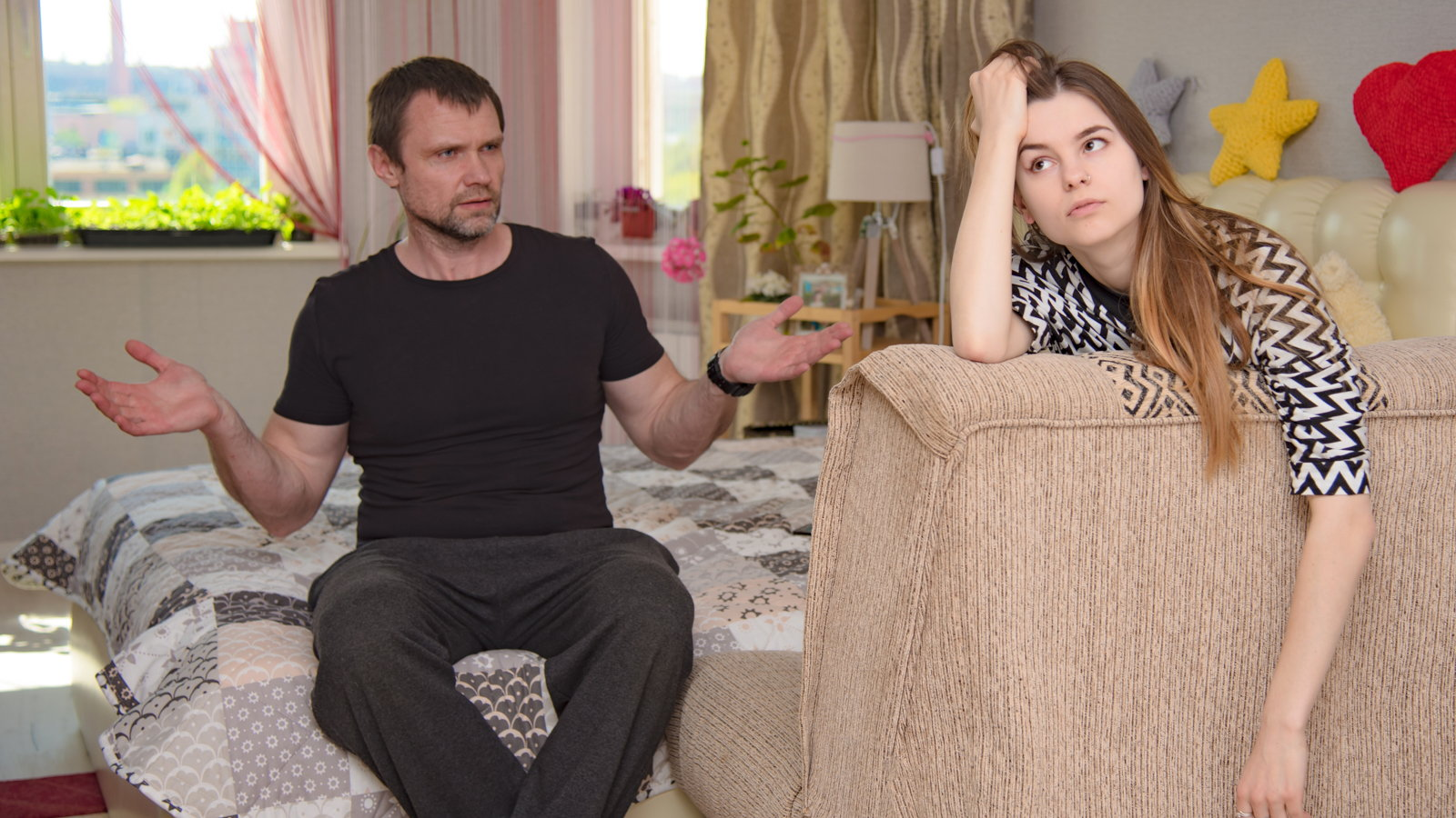 dad talking to teen daughter
