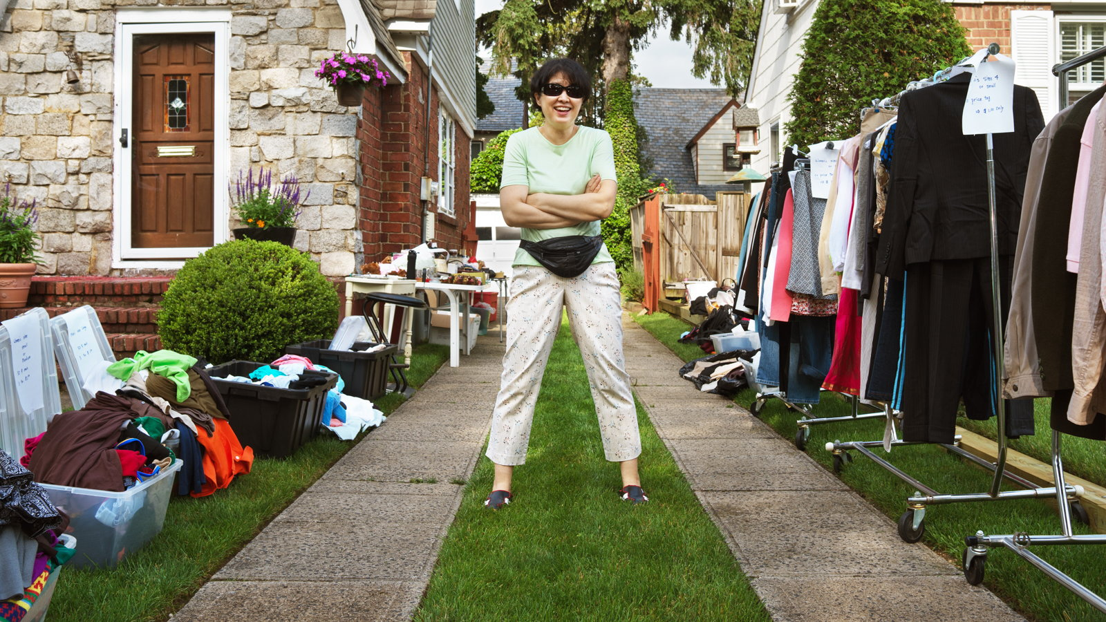 woman organizing yard sale