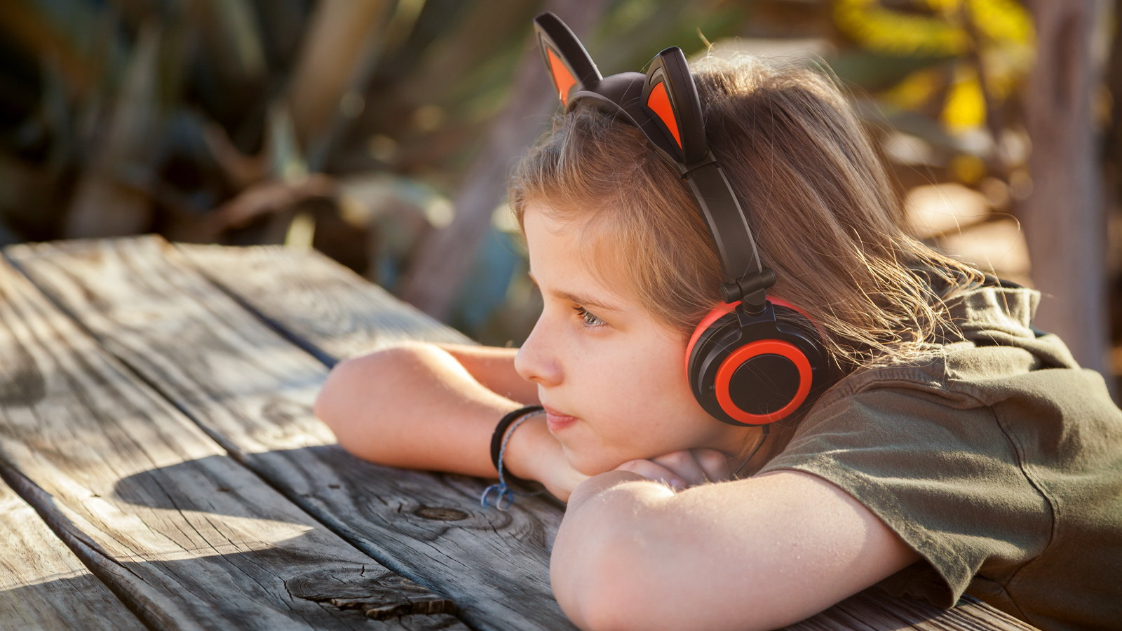 child listening to music with headset