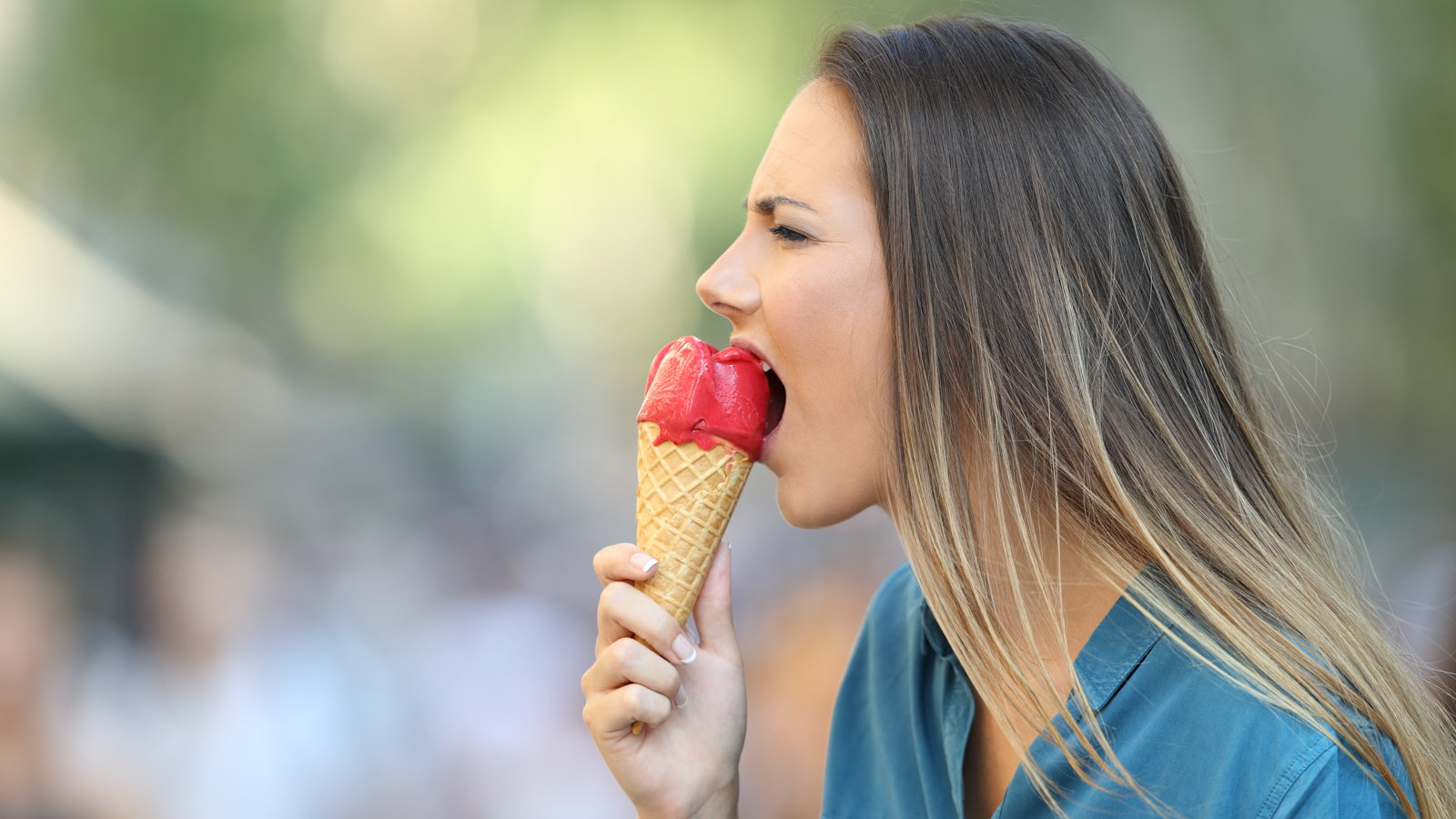 woman eating icecream cone