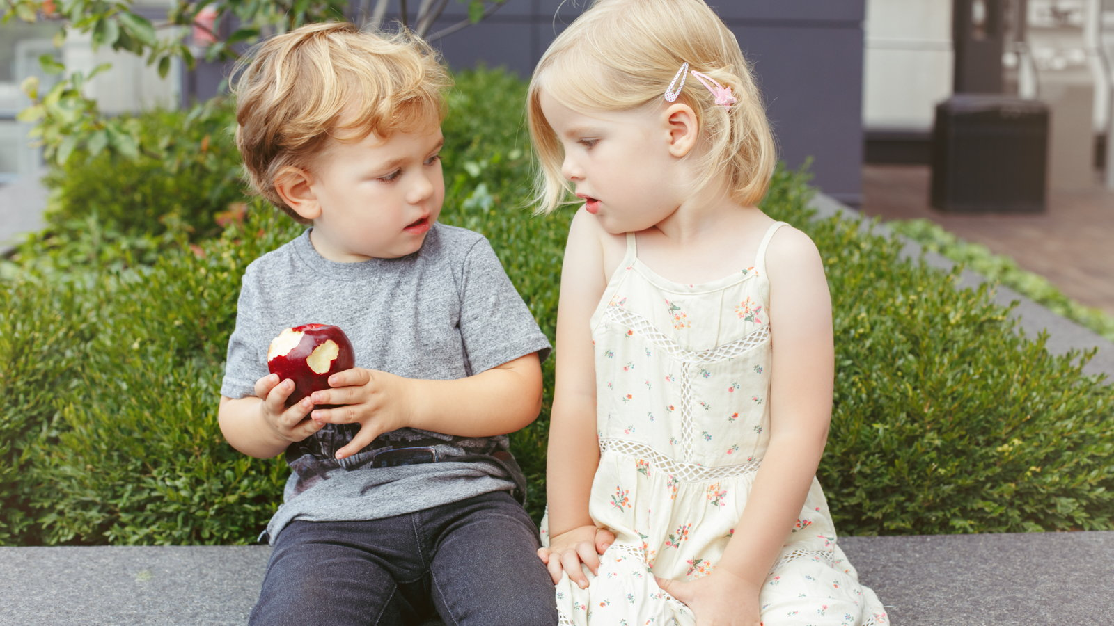 brother and sister sharing an apple