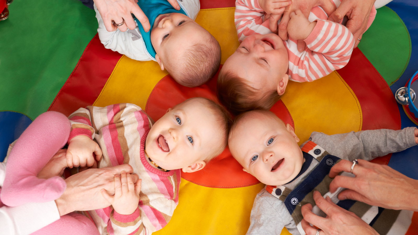 babies on a playmat at daycare