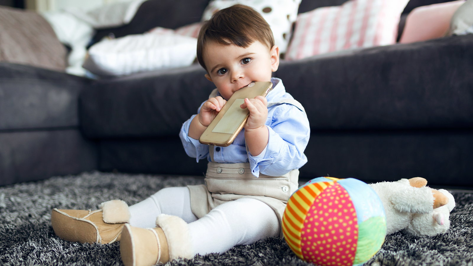 toddler chewing on cellphone
