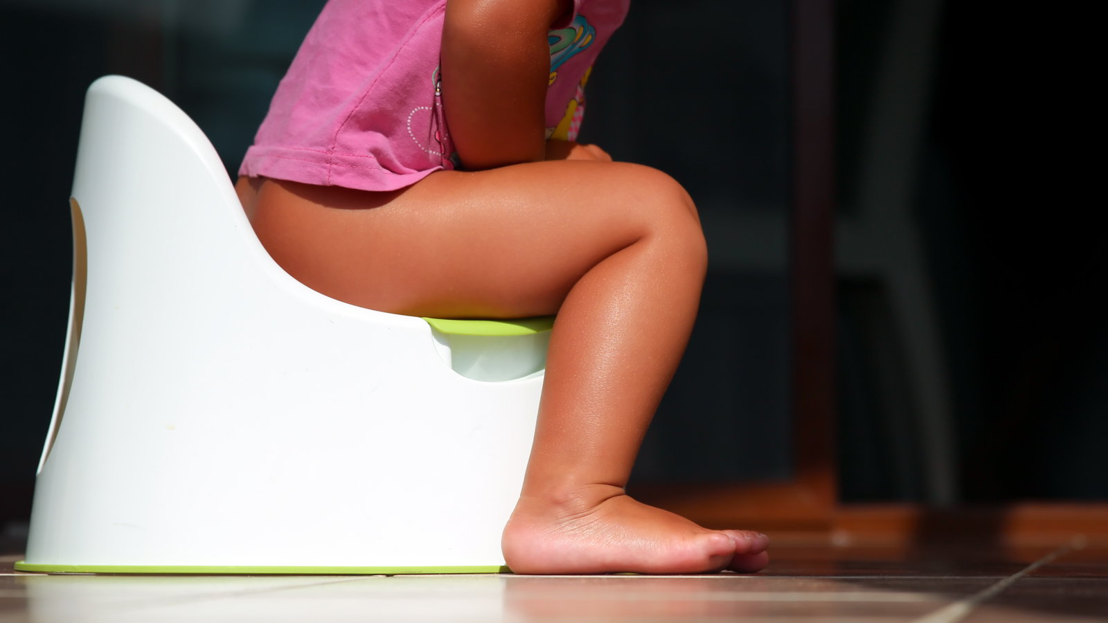 girl sitting on potty seat