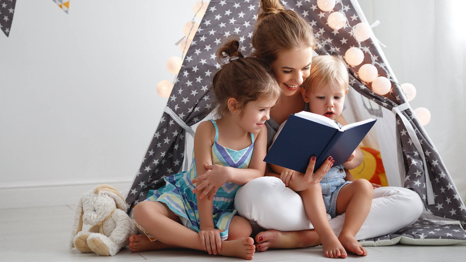 mom reading to young children