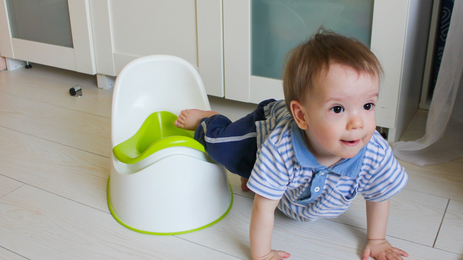 boy climbing off of potty seat