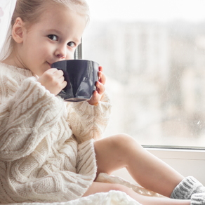 child drinking out of mug