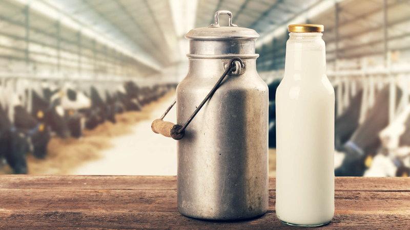 jar of fresh milk next to bottle of milk
