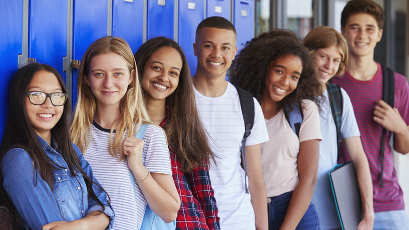 teens standing by lockers at school