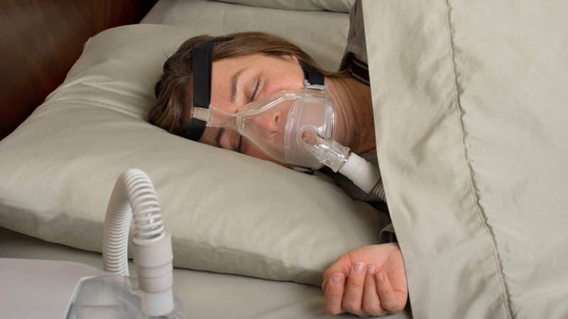 lady using CPAP for sleep apnea