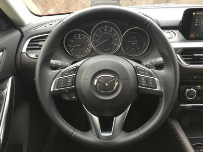 2016 Mazda Mazda6 Grand Touring steering wheel and instrumentation detail