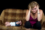 new mother struggling with postpartum depression
