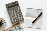 calculator, cash, pen and pad