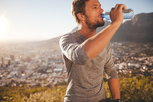 man drinking water to stay hydrated