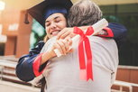 recovery school graduate hugging parent