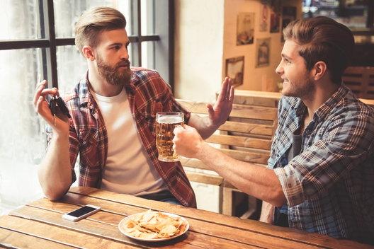 man being peer pressured by a friend