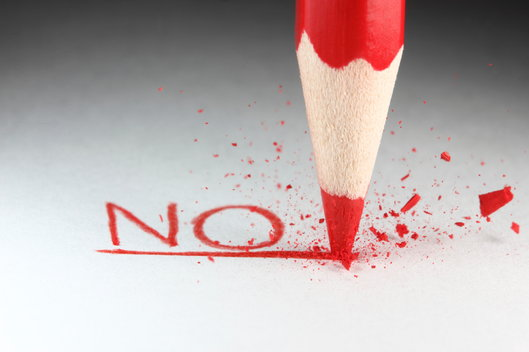 red pencil writing the word no