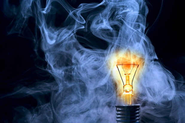light bulb diminishing into smoke
