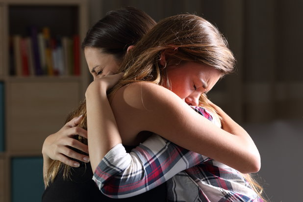 Friends hug as one seeks support and recovery after sexual assault