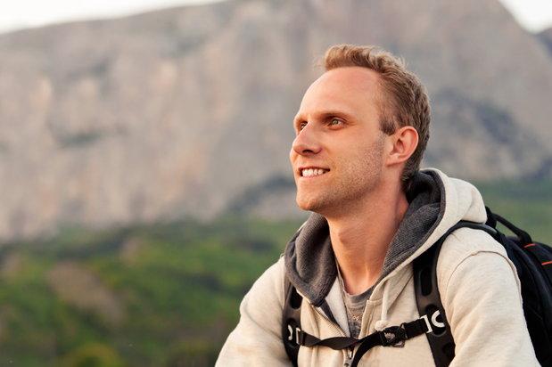 smiling man hiking