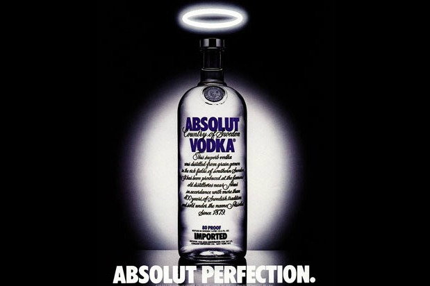 Absolut Vodka bottle with halo with text: Absolut perfection