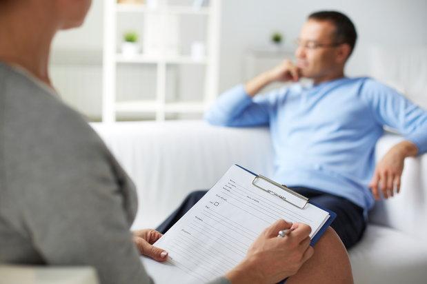 man sitting with psychiatrist