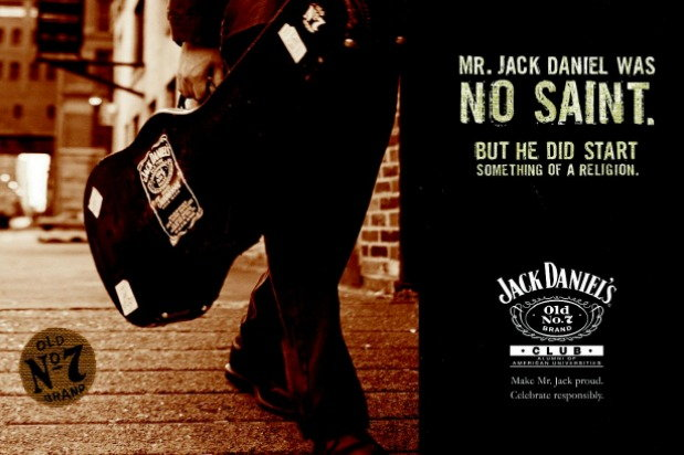 advertisement: person holding guitar with Jack Daniel's sticker