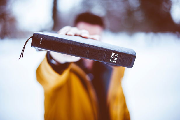 Man holding bible