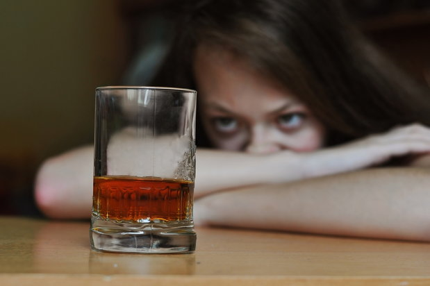 woman fights the urge of alcoholism