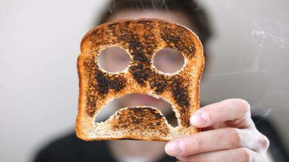 A piece of burnt toast with a ghost face.