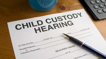 Child custody hearing paperwork.