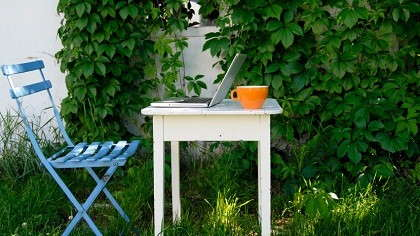 A work desk setup in a garden.