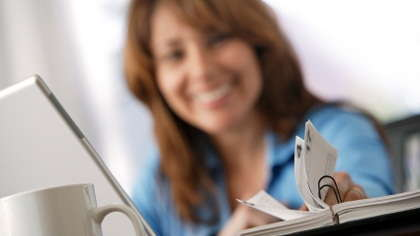 A woman examining her schedule planner.