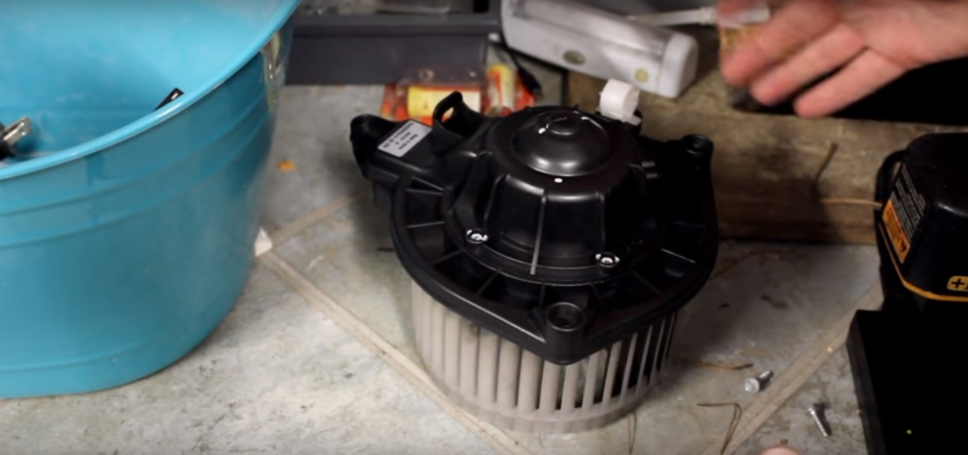Remove the blower motor and clean out any foreign material that might be inside it