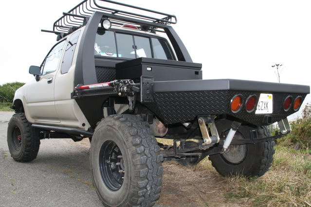 Flat bed conversion with a tool box and built in jack
