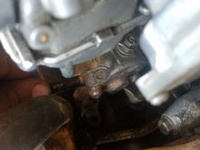 Its right under the carburetor