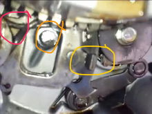 The red circle is the spring I'm referencing, this picture is from the video but mine was in the same place. 