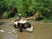 Cody in creek at Badlands