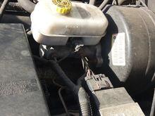 No fluid leaks at reservoir or under engine compartment