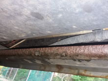 Which one is brake line? Corroded line or metal line?