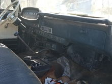 Has an almost unmolested dash, with the factory radio and A/C evap