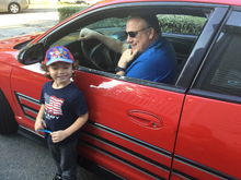 My brother in his '04 SS Dale Jr car and my son Giovanni.   My kids love his victory red Monte!