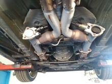 Long tube BBK headers/with high flow cats with QuickTime electronic cutouts. Running back 4 inch mufflers
