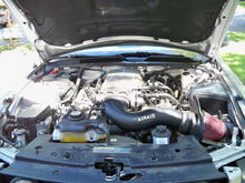 My dirty engine bay with my intake.