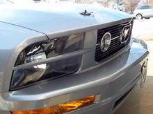 New black pony package billet grill, headlight splitters, and black hood-pin appearance kit.