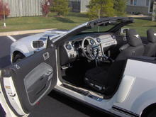 """Latest 'Stang pictures 005 Shows chrome lasered door sills, custom knobs and levers - custom brake and gas pedals - custom tu-tone steering wheel.  Carbon fiber """" Silver Wire"""" full dashboard - chrome covers on dashboard A/C/heat vents - embroidered running horse on rear of headrests - custom door panels with chrome surround."""